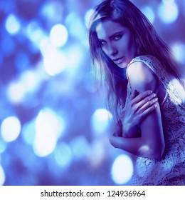 Beautiful fashion woman. Color face art photo toned blue.