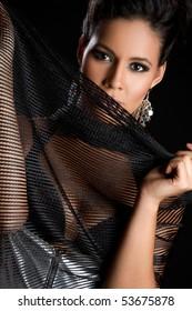Beautiful fashion woman holding scarf