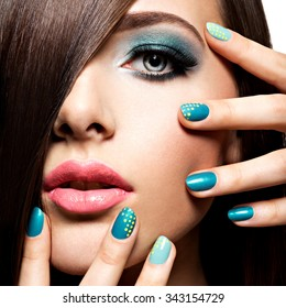Beautiful fashion young adult girl with turquoise make-up and nails