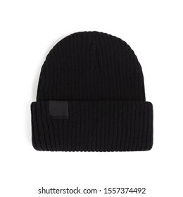 Beautiful fashionable black knitted wool hat lies with a shadow on a white background, for design, mock-up