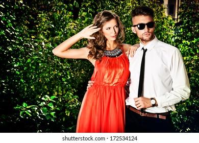 Beautiful fashionable couple standing outdoor.