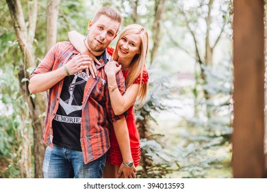 Beautiful fashionable couple standing outdoor