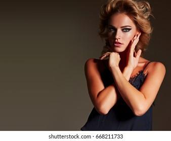Beautiful fashionable girl in the studio.