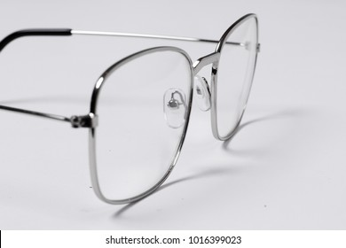 Beautiful and fashionable glasses with transparent glasses on a white background