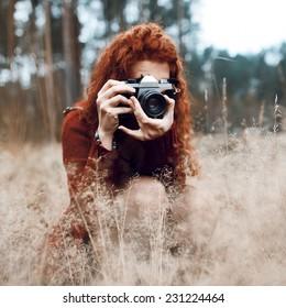 Beautiful fashionable hipster girl - photographer