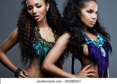 beautiful fashionable woman with blue decoration
