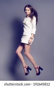 Beautiful fashionable woman in flight, studio