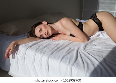 beautiful fashionable woman in lingerie in the bedroom on the bed