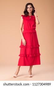Beautiful fashionable woman in nice dress, handbag and accessories. Fashion spring summer photo