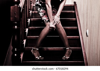 beautiful fashionable woman at the stairs