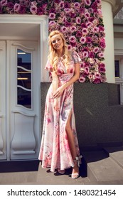 Beautiful fashionable woman walking in the street, wearing nice dress, high heels.Fashion urban spring summer photo.