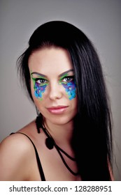 beautiful fashionable young woman with creative art make up in studio