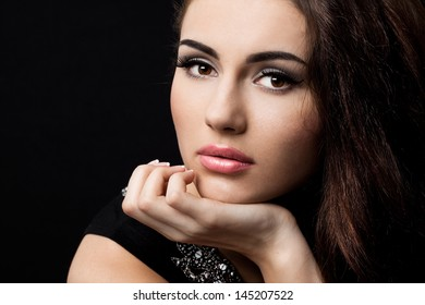 beautiful fashioned woman on black background