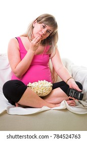 Beautiful fat young woman watching TV and eating popcorn