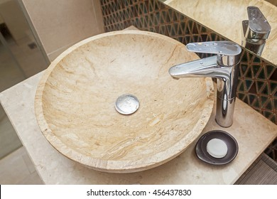 Beautiful faucet and marble sink in a bathroom