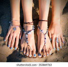 Beautiful feet jewelry on the beach