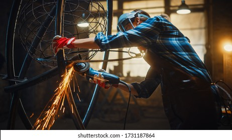 Beautiful Female Artist Uses an Angle Grinder to Make Brutal Metal Sculpture in Studio. Tomboy Girl Polishes Metal Tube with Sparks Flying Off It. Contemporary Fabricator Creating Abstract Steel Art.