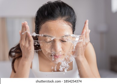 Beautiful female asian use water to wash your face Wash face.