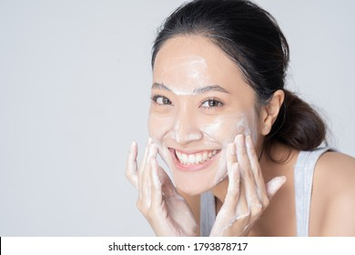 Beautiful female asian Wash face in studio