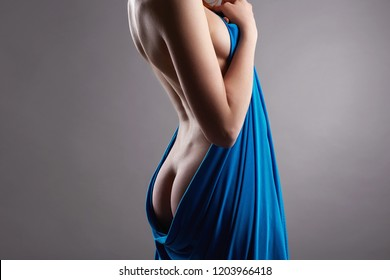 Beautiful Female Back and Booty. Nude Woman Body. Naked girl wrapped in Blue cloth