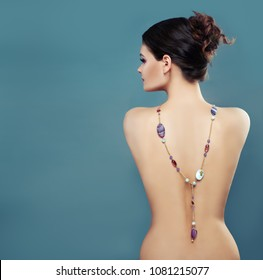 Beautiful Female Back and Profile with Gem Jewelry Necklace on Blue Background with Copy space, Fashion Portrait
