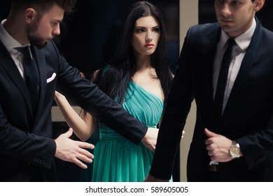 Beautiful female celebrity with two bodyguards