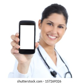 Beautiful female doctor smiling and showing a blank smart phone screen isolated on a white background