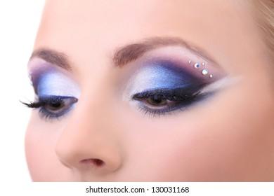 Beautiful female eyes with bright blue make-up