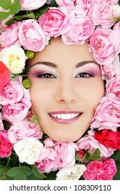 beautiful female face with flowers roses frame isolated on white background