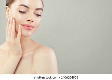Beautiful female face. Healthy model with clear skin. Skincare and facial treatment concept