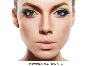beautiful female face with rainbow makeup. girl looking at camera