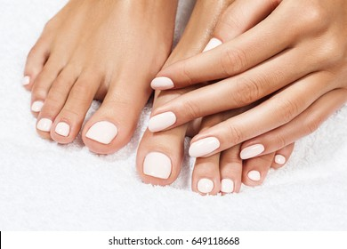 Beautiful female feet over white background.
