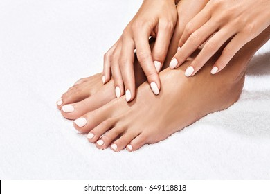 Beautiful female feet over white background.