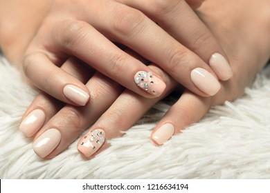 beautiful female fingers with professional manicure closeup