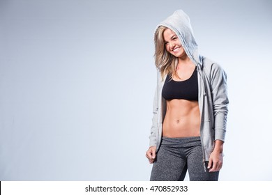 Beautiful female fitness model getting ready to start training in a studio