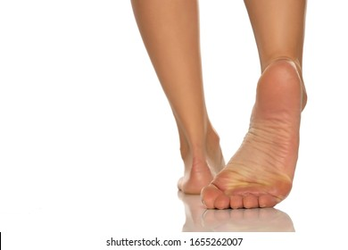 beautiful female foot on white background