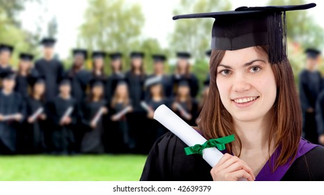 Beautiful female graduate outdoors with a group behind her