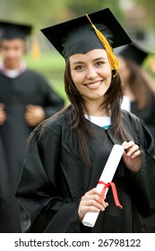 Beautiful female graduation portrait standing outdoors