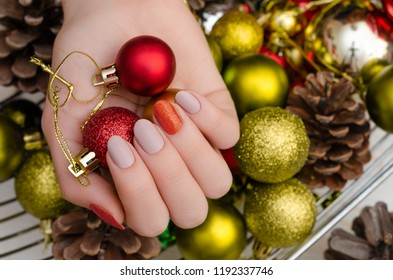 Beautiful female hand with christmas nail design.