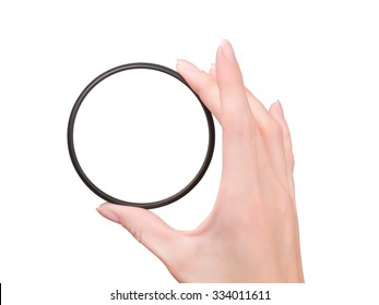 Beautiful female hand holding camera filter isolated on white with clipping path. First person view