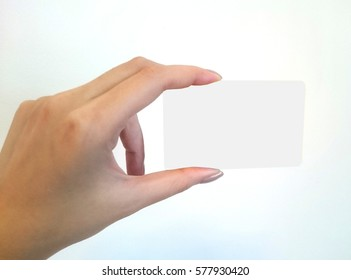 Beautiful female hand holding a empty business card