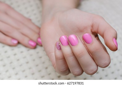 Beautiful female hand with pink manicure.