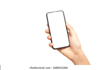 Beautiful female hand with sunlight holding modern mobile phone white screen isolated on white background
