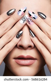 beautiful female hands cover her face.manicure. Close-up fashion Portrait.Model Girl Face. Make-up and nails