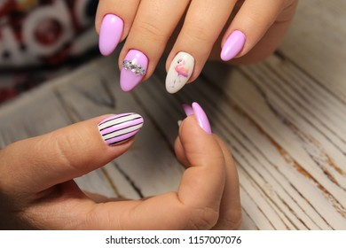beautiful female hands with a fashionable manicure on the background