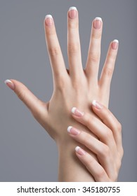 Beautiful female hands with french manicure on nails