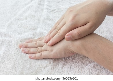 Beautiful female hands on fabric background