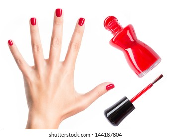 Beautiful female hands with red manicure and  nail polish  bottle with  brush