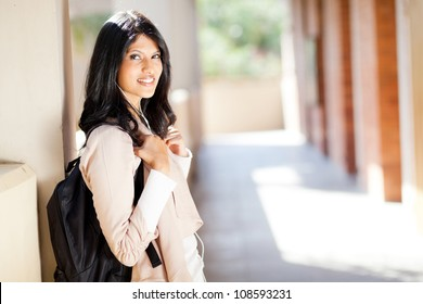 beautiful female indian college student portrait by corridor