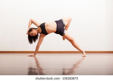 Beautiful female jazz dancer showing off in a dance studio